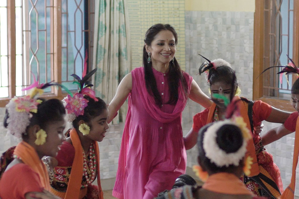 A candid moment of dance and celebration at Adruta Home