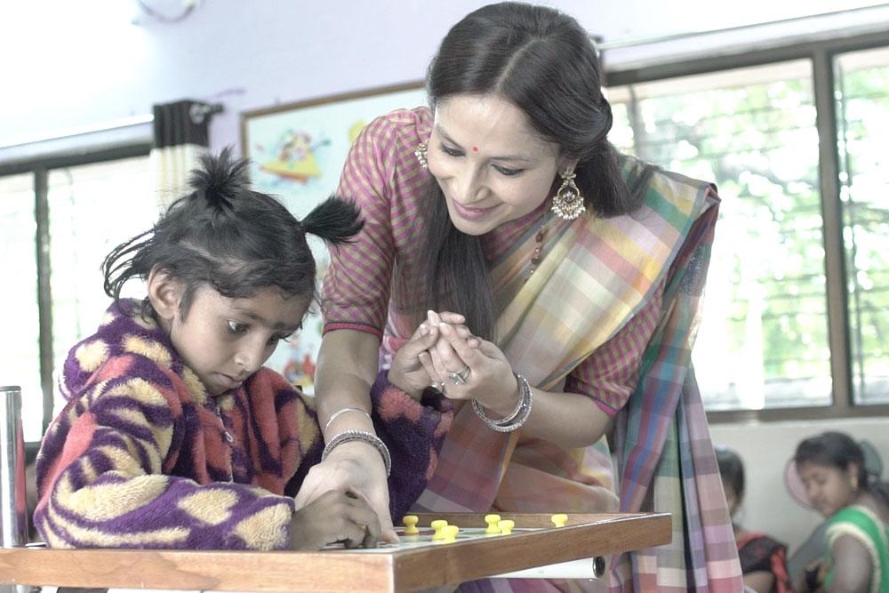 Teaching a Child at Asha- The Hope