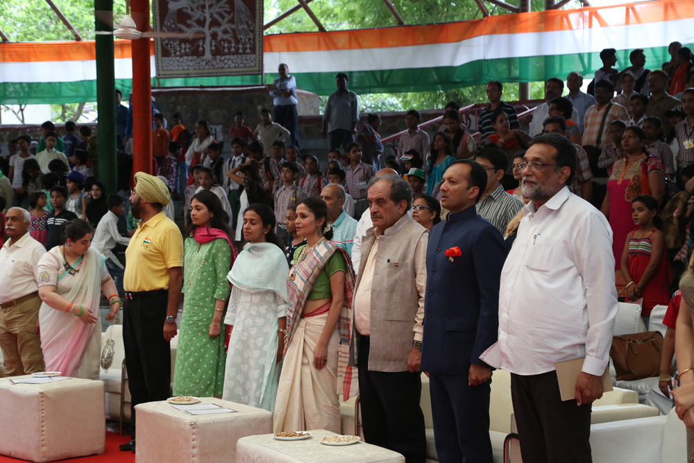Honorable Guests at Flag Installation Ceremony Paying Respect to National Anthem