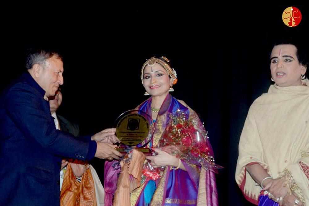Receiving the `Devdasi National Award` and `Natyashree` at Devdasi Nrutya Mandir